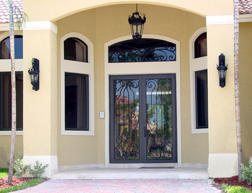 Bronze full view with grey glass and custom ornamental ironwork on the front entry door